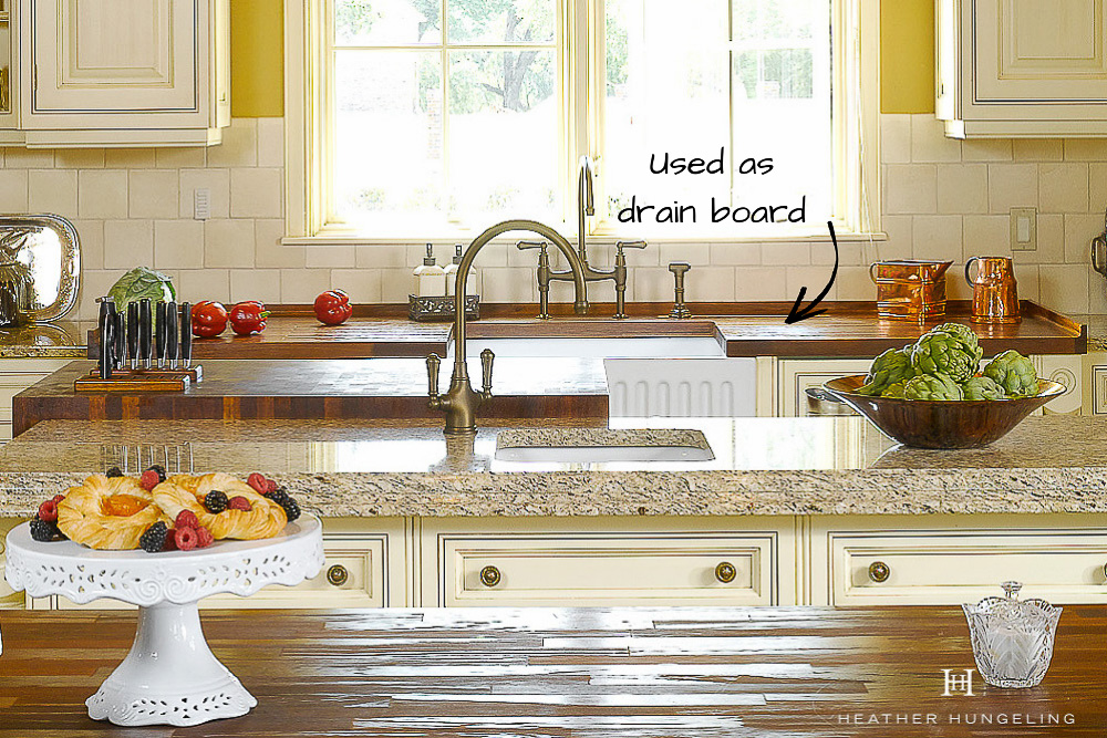 Iroko wood countertops are an excellent option for use around a kitchen sink. They can be designed as a drain board, with drain grooves routed into the wood and an upstand edge to contain run-off.