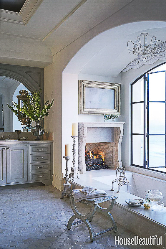 This bathroom obviously has a lot going for it, but that fireplace at the foot of the tub just leaves me speechless. See more Master Bathtub Ideas. #luxurybathrooms, #traditionalbathroom