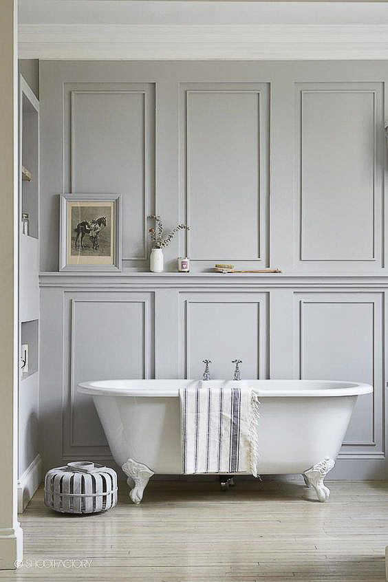 We need more paneled bathrooms in this country. Nothing evokes a sense of luxury and refinement quite like a beautifully paneled master bathroom. I love the minimalist take on this one, with no need for a window over the tub. See more Master Bathtub Ideas. #luxurybathrooms, #traditionalbathroom