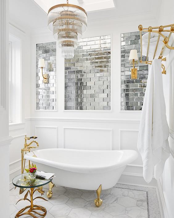 I love how the designer integrated the crisp, white paneling with the mercury glass tile work above the freestanding tub. See more Master Bathtub Ideas. #luxurybathrooms, #traditionalbathroom, #whitebathrooms  Designer: SuzAnn Kletzien Design