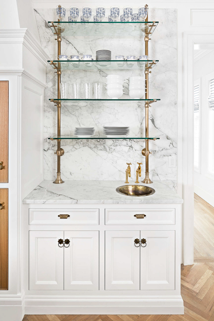 Brass continues to reign in kitchen designs for 2019. We'll see more brass shelving, hardware, and plumbing fixtures, along with brass inlays in flooring and cabinetry. Kitchen Trends 2019. #kitchentrends, #luxurykitchens, #kitchendesignideas
