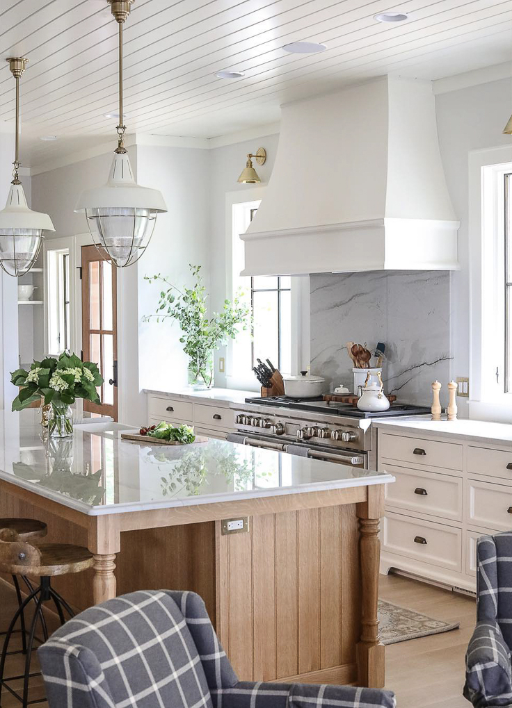 The all-white kitchen is giving way to one with a blend of tones and textures in 2019. Introducing some light wood-toned cabinetry into an otherwise white kitchen design is one way to make it look fresh.  Kitchen Trends 2019 . #kitchentrends, #luxurykitchens, #kitchendesignideas