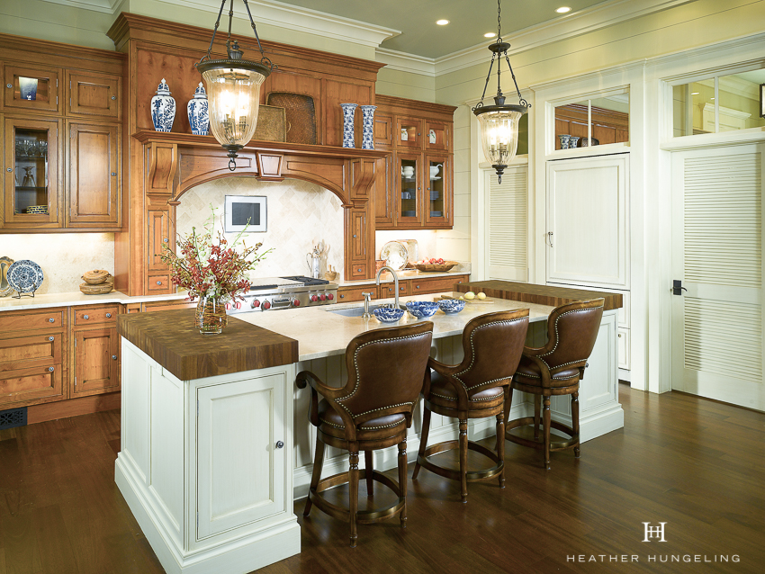Yew wood, a warm-toned wood species from England (often associated with antiques), was selected for part of the cabinetry to infuse this Lowcountry home with a sense of history. #luxurykitchendesigns, #clivechristian, #traditionalkitchens