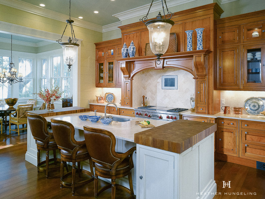 Lowcountry homes often have a quiet and soulful quality to them, so the interior design of the space should never feel overly done or contrived. A traditional wooden hood surround was chosen to compliment the historic nature of this kitchen, but was kept fairly simple so as not to compete with the stunning view. #luxurykitchendesigns, #clivechristian, #traditionalkitchens