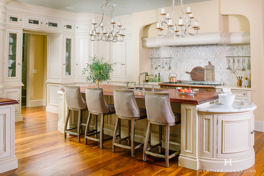 Willow Lane Project Reveal. How creating a double island kitchen solved this home's problems caused by an awkward room shape. Painted cream cabinetry by Clive Christian. Designed by Heather Hungeling. #luxurykitchens, #doubleislands, #kitchenlayout, #clivechristian