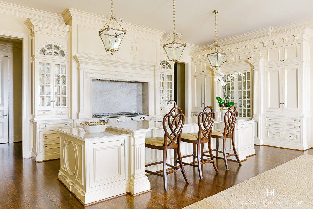Kitchen Cabinetry Design Mistake #5: Making your kitchen too basic. You can introduce classic style and timeless character if you stick with cabinetry details that are relevant to the architectural style of your home. This kitchen was designed for a very elegant Georgian-style home and will weather the rise and fall of trends. #kitchencabinetrydesign #luxurykitchendesigns, #clivechristian, #traditionalkitchens,