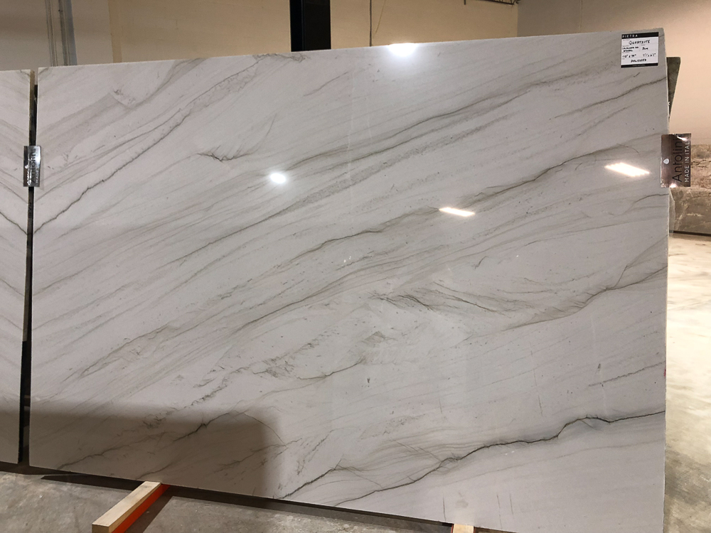 A beautiful slab of Calacatta Do Brasil quartzite, offered by  Pietra    Luxury in Stone   in Atlanta, GA. Quartzite, a natural stone, is a great alternative to marble for kitchens because it does not etch.  #kitchencountertops, #marblecountertops, #luxurykitchendesigns #traditionalkitchens