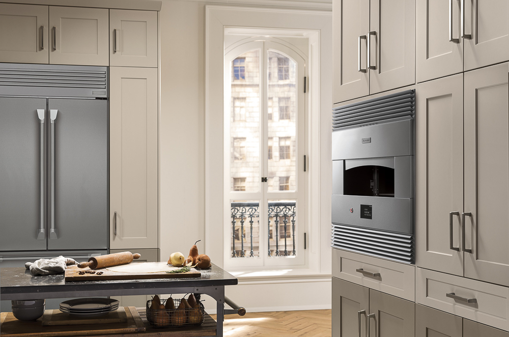 "Monogram's latest new kitchen product introduction for 2019 is a ""Hearth Oven."" Not only can you use it for pizzas, but creative cooks will find several other uses for it. Here, it's shown mounted flush into a standard 30"" wide oven cabinet."