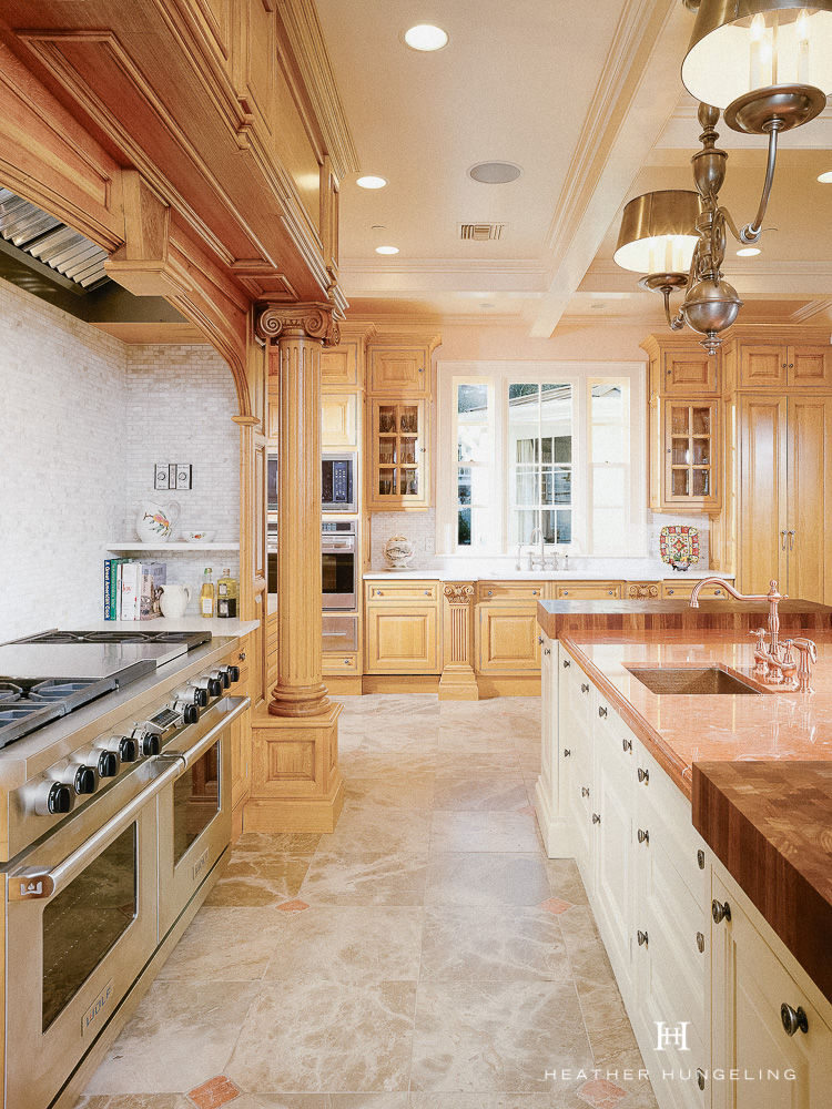 Luxury kitchen design principle #4: luxury kitchens favor natural countertop materials, like marble, quartzite, and wood.  #luxurykitchens, #kitchendesign, #clivechristian, #luxurykitchendesigner