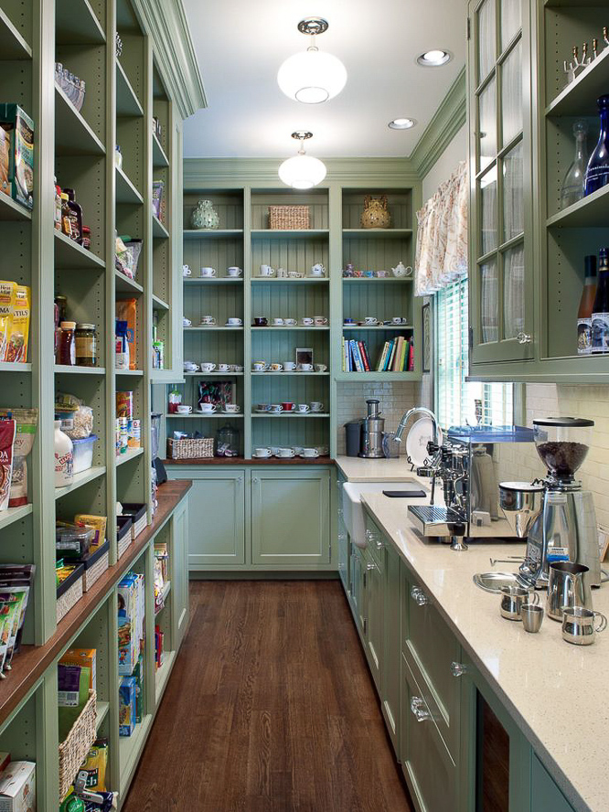 This fabulous prep kitchen combines all of the functional benefits of a prep space with the über convenience of a walk-in pantry. All of your pantry staples can be kept right at your fingertips, as well as an assortment of countertop appliances…all out of sight from the main kitchen.  #kitchendesign #luxurykitchendesigner #butlerspantryideas #kitchenlayouts