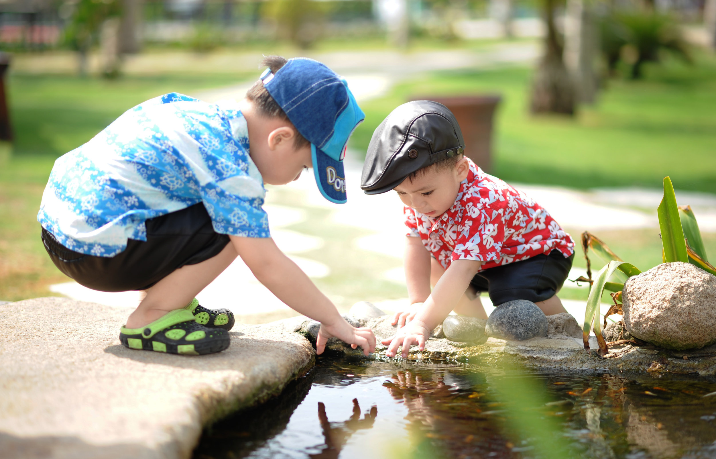 Canva - Boy in Blue and White Shirt Playing Near on Body of Water With Boy in Red Shirt.jpg