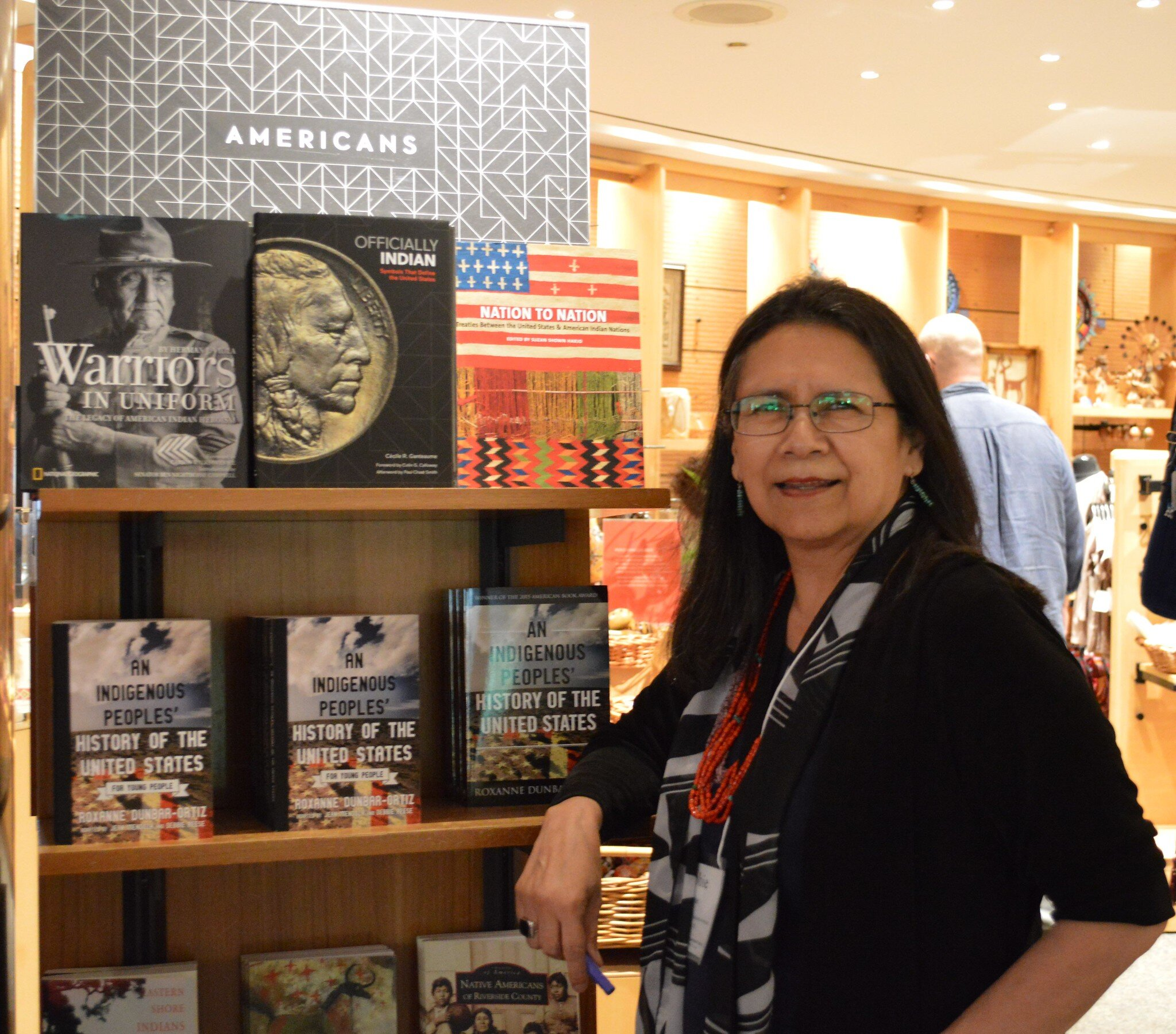 Debbie Reese preparing for book signing at the NMAI bookstore.