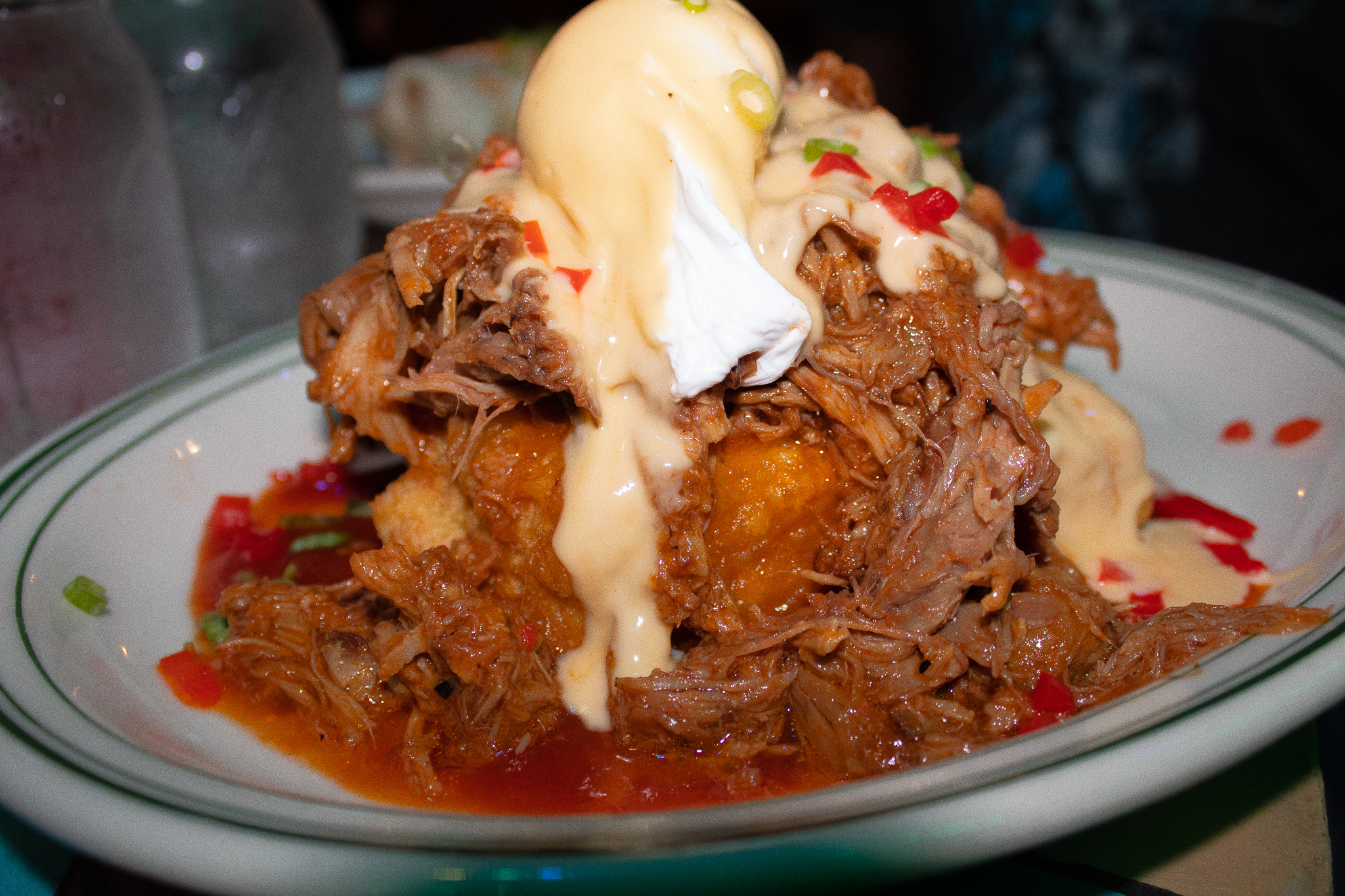 South by Soutwest Benedict - crispy corn tamale, smoked pulled pork bbq, and hollandaise sauce