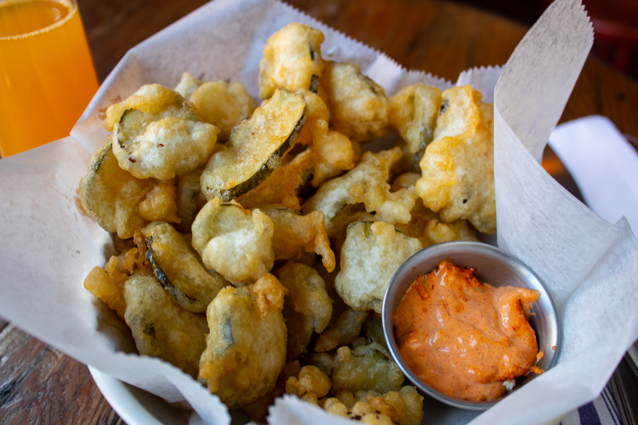 Beer Battered Pickles - Round slices fried in pale ale batter, spicy remoulade