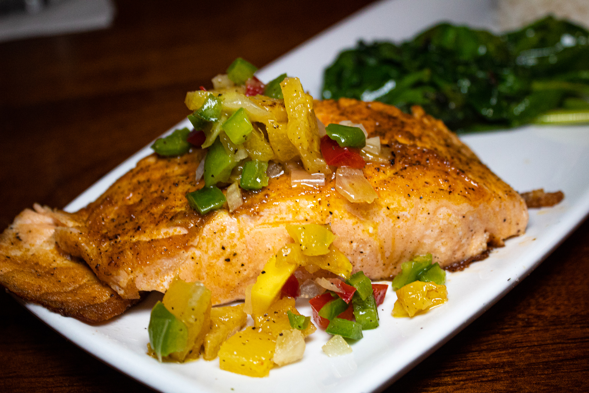 SPICE DUSTED SALMON -  Coconut Scallions Basmati Rice, Sautéed Spinach & Mango Pineapple Salsa