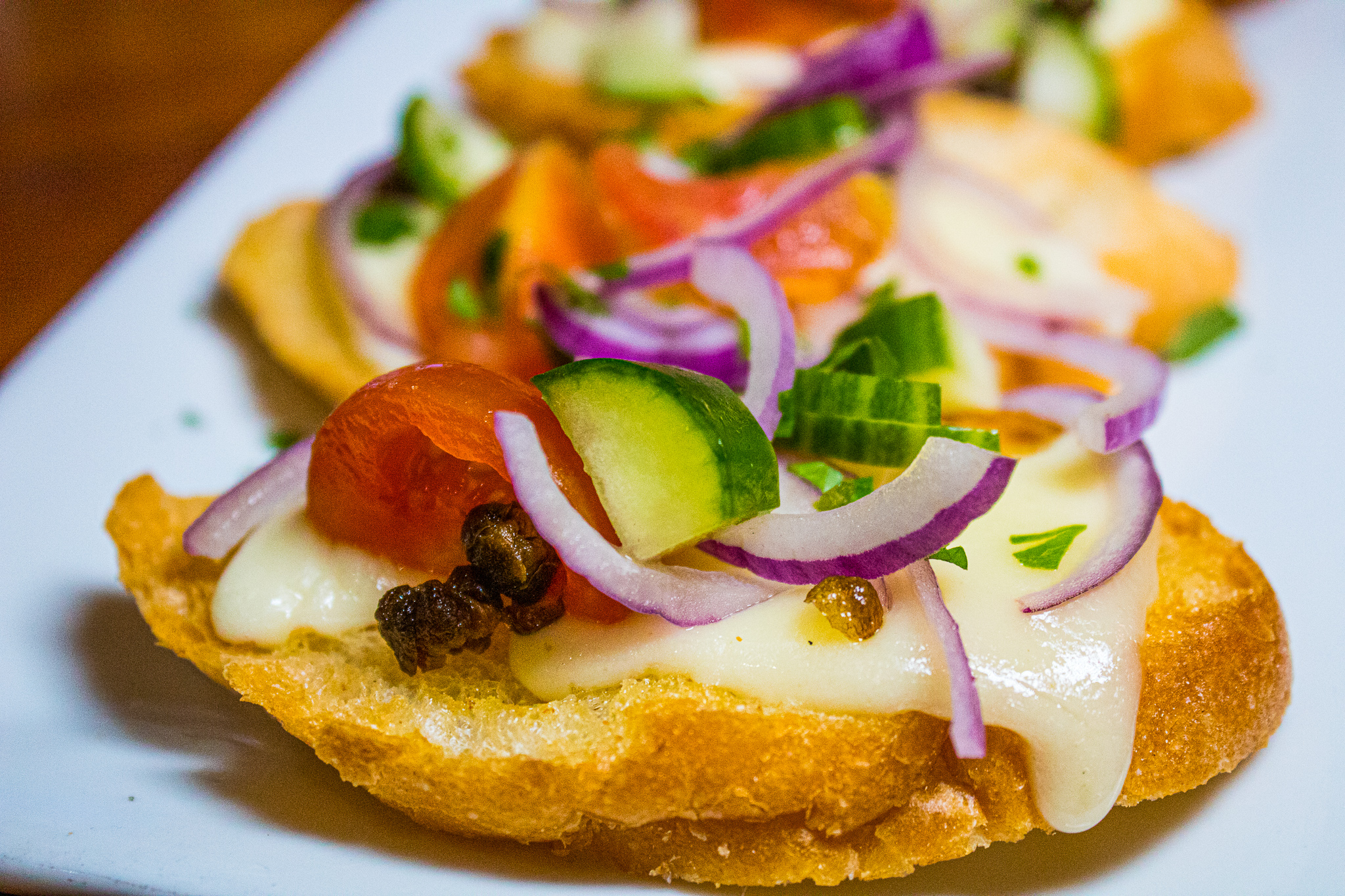 HARTMAN'S BRUSCHETTA -  Mozzarella Cheese, Tomato, Basil, Red Onions, Capers, Cucumber