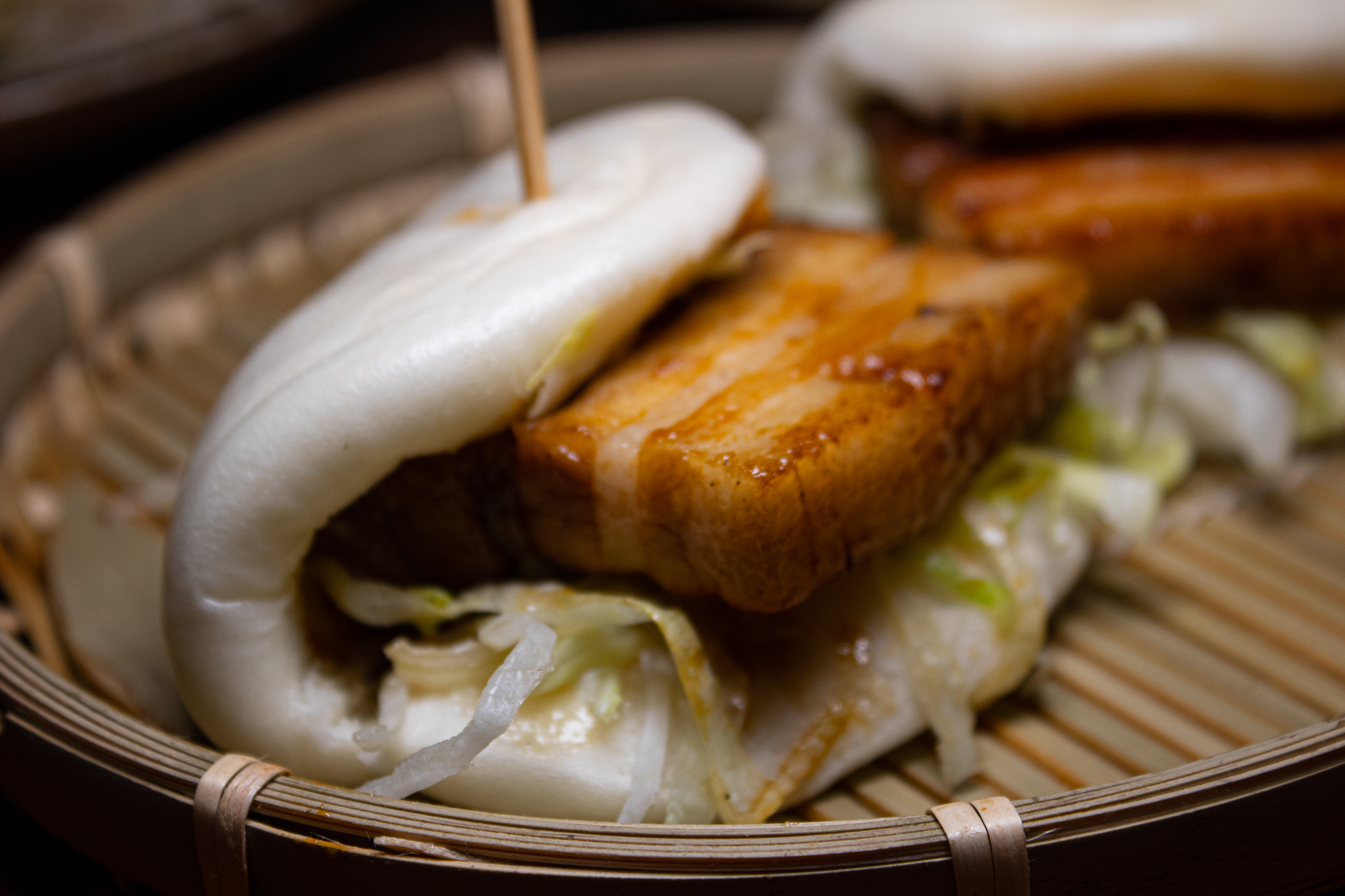 Pork Bun - soy glazed pork belly, pickled vegetables, mustard seeds, bean paste aioli