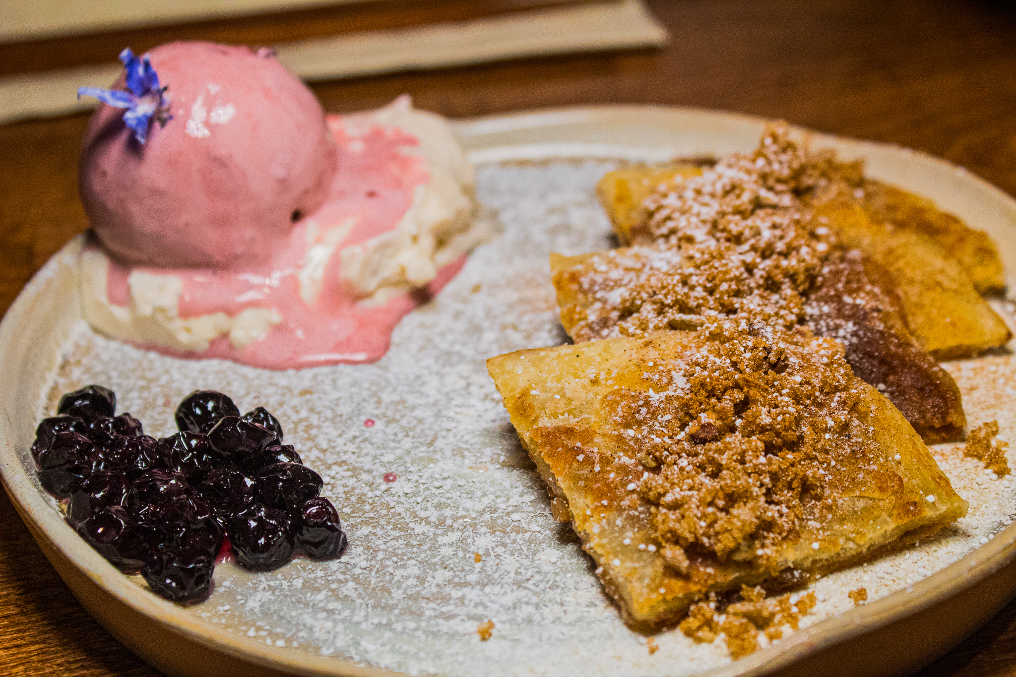 Hotteok - Korean sweet pancake, pecan, walnut, sunflower seed, red bean ice cream, blueberry whipped cream, and blueberry compote