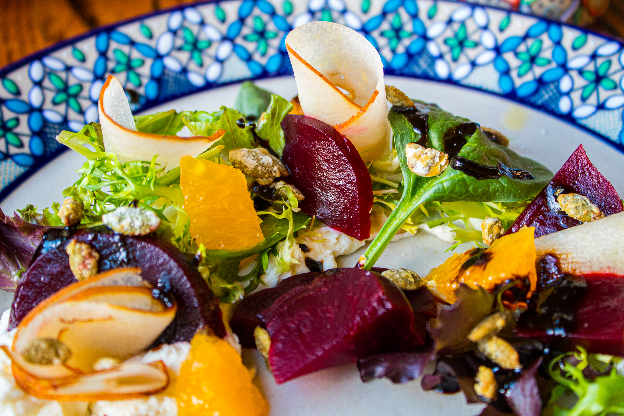 Roasted Beet Salad - Apple, Candied Pumpkin Seeds, Orange, Baby greens. Requeson & Tamarind-Balsamic Glaze