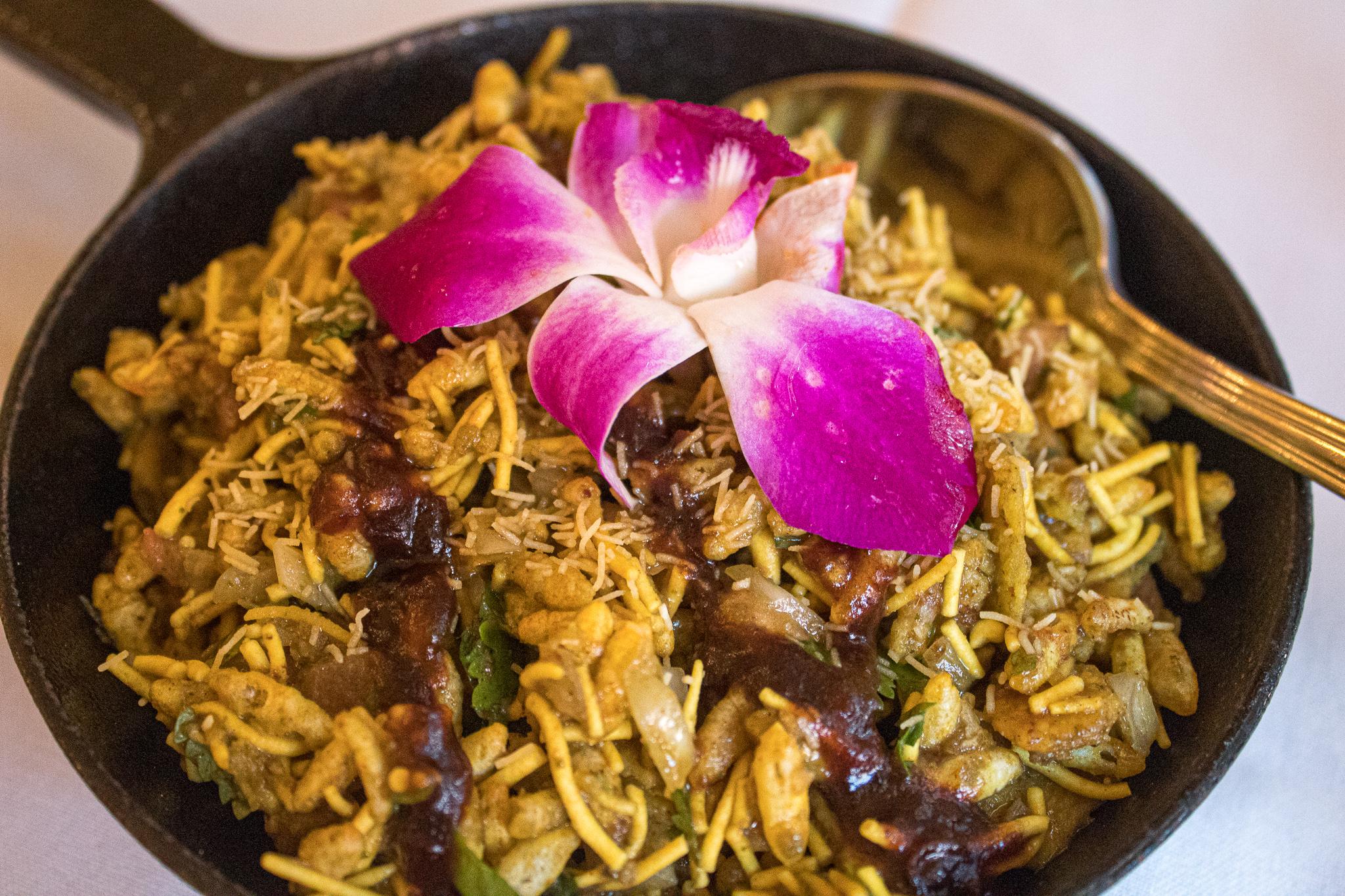 BHEL PURI - mixture of rice puffs, red onions, tomatoes & chutneys