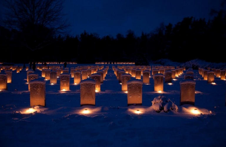 Finland:Mingle with friends in a cemetery  - On Christmas Eve, it's a tradition in Finland to light a candle and head to a cemetery to honor the dead. This is not an invite-only event, so friends & strangers are likely to meet amongst the graves to reflect. And you thought your family dinner was morbid.
