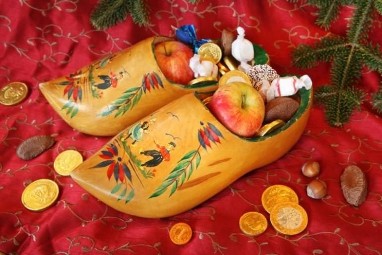 Holland:Eat snacks from your shoe   - Another foot-centric Christmas tradition takes place in the Netherlands on December 6th, when kids place their shoes in front of the fireplace for Sinterklaas (a kind bishop) to fill with treats. Pumped-up kicks for real.