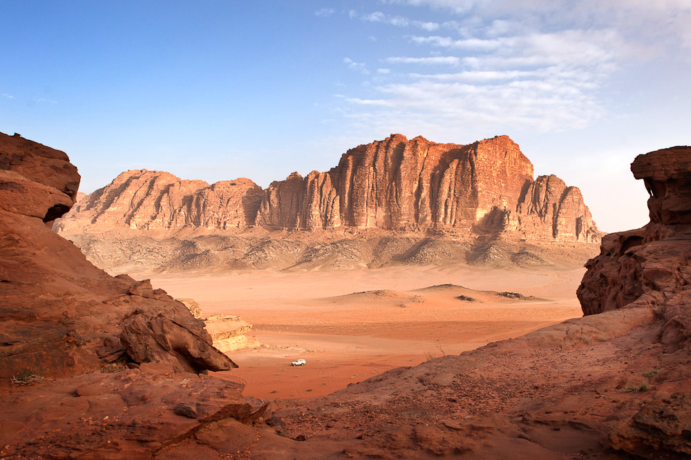 9. Wadi Rum, Jordan - Even if you're a sworn ocean lover,preferring the misty climes of Oregon to the aridity of Arizona, you won't be able to resist the beauty of Wadi Rum. Sign up for a Bedouin-led desert safari,and navigate the canyons while atop a camel, or the back of an old-school Jeep 4x4. Do go off-roading: the rush of running down a sand dune in the Jordanian desert,leaping into the air towards the vast, light blue, Middle Eastern sky, is simply unparalleled. The people are also amongst the friendliest in the world. Our guide brought us to meet his family later that night. They were camped miles away across the desert. We shared tea beneath the stars.