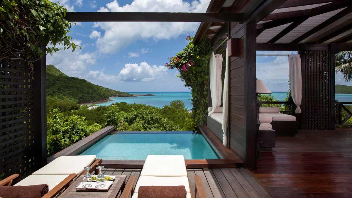 AntiguaBarbados-Hermitage-Res-HillsidePoolSuite-PoolChairsLounge-UHD.jpeg