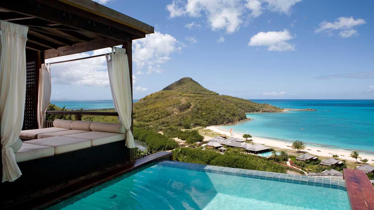 AntiguaBarbados-Hermitage-Res-HillsidePoolSuite-PoolDaybedHero-UHD.jpeg