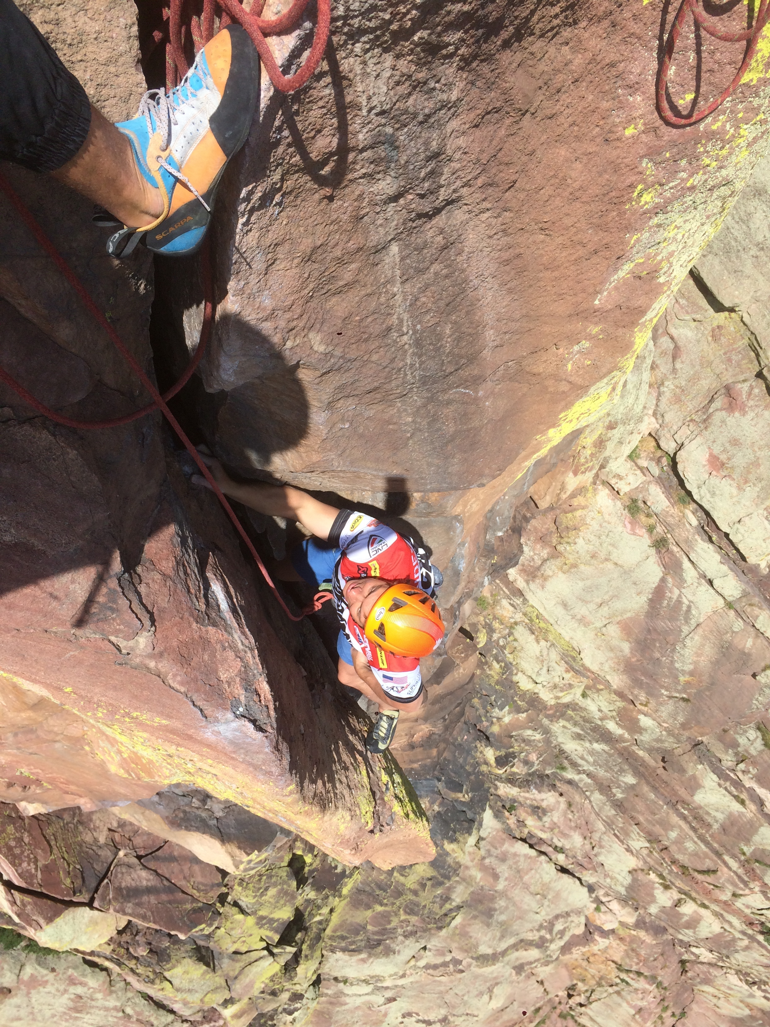 Looking down the last 5.11 pitch from the super exposed belay before a mellow romp to the top.