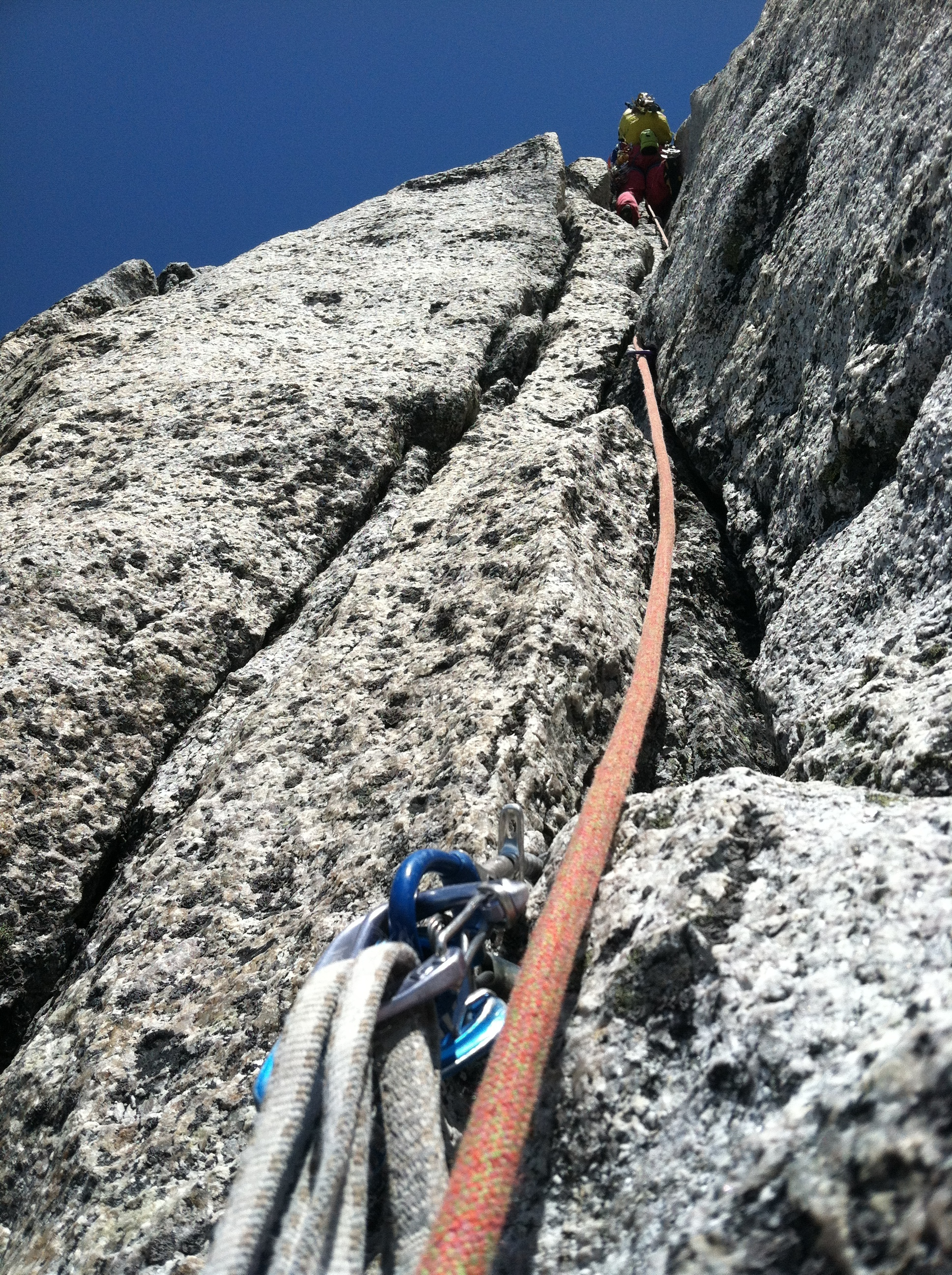 Bugaboos climbing is characterized by pristine granite cracks, and sometimes you must climb them with a full alpine pack. Photo by Brent Butler on the legendary Becky Chouinard during a beautiful dry spell in July '12.