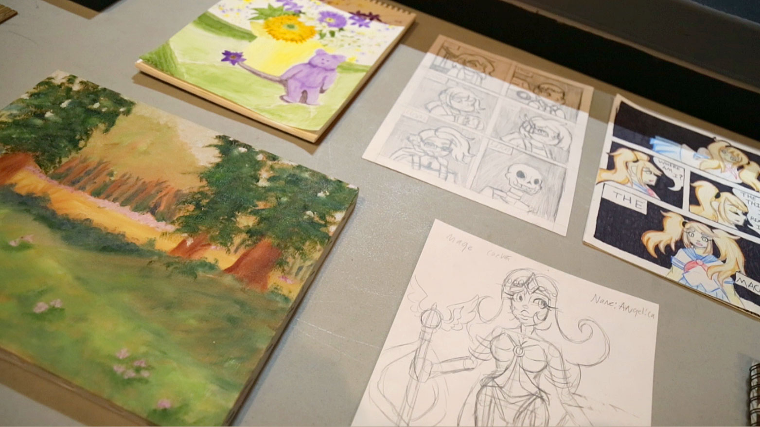 Pieces of student artwork are shown