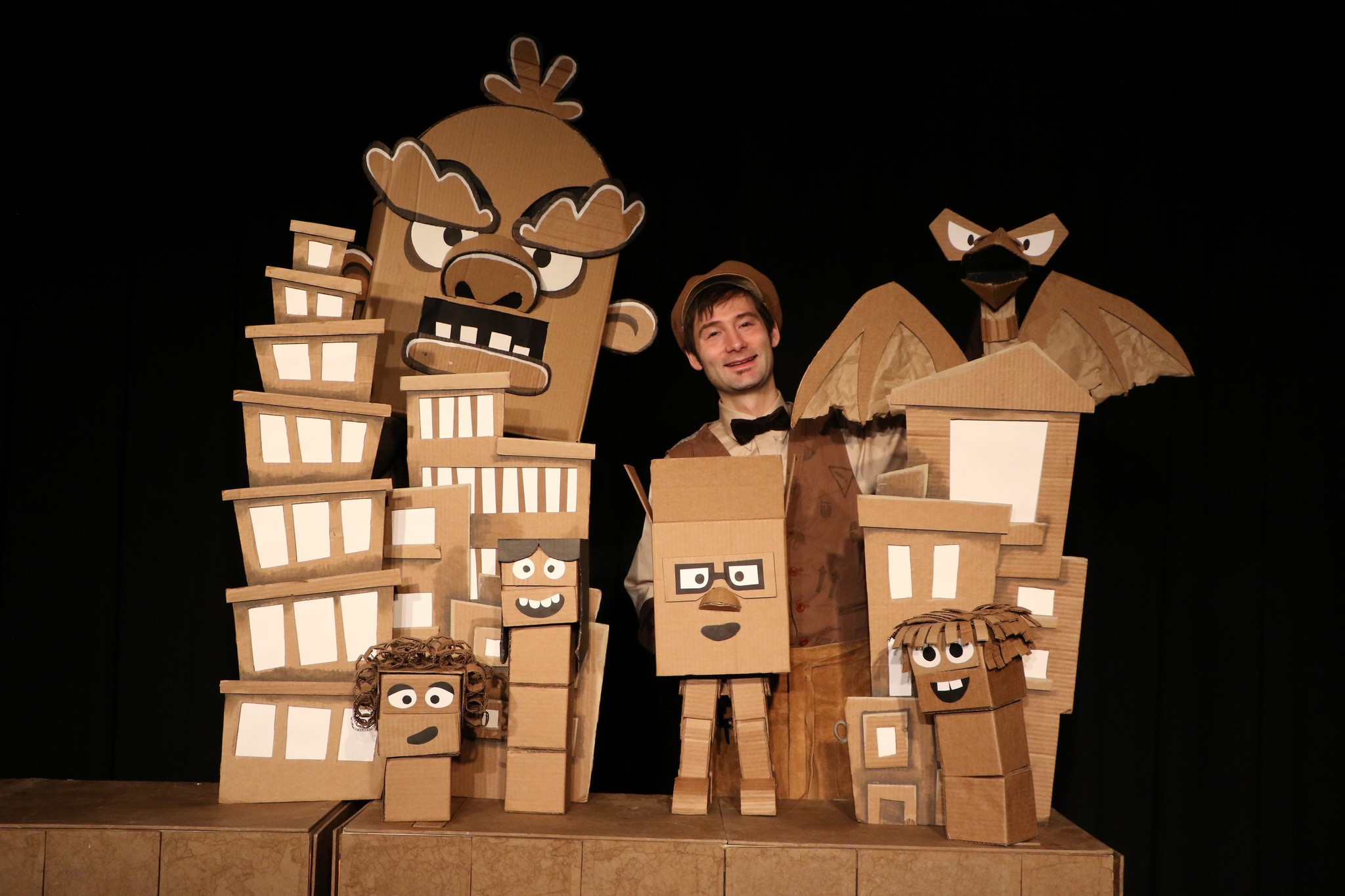 Puppeteer Brad Shur transforms simple cardboard shapes into elaborate puppet characters and brings them to life in  Cardboard Explosion!  [Photo by Graham Gardner]