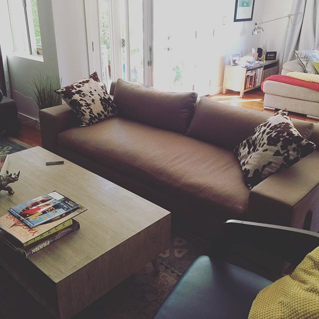A client sent us this photo of their gorgeous Mauricio Sofa from @patagonia_home in his living space. Looks great Geoff! #Patagonia #home #sofa #wood #livingroom #hide #pillows #manden #upholstery #design #interiors