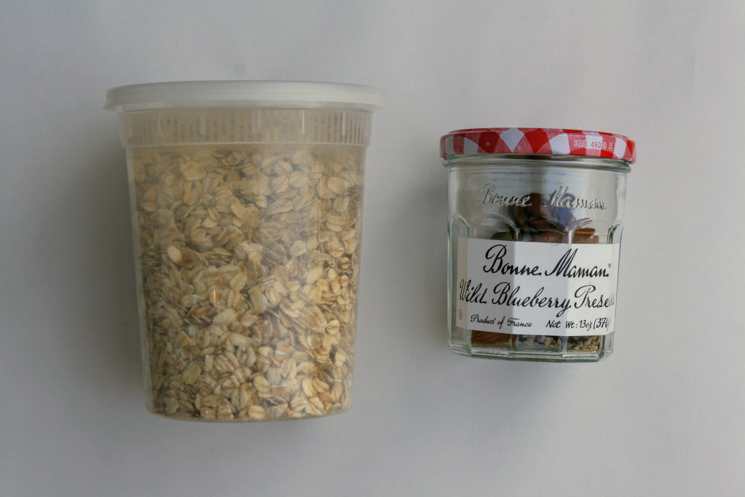 Mismatched, leftover containers are perfect items to reuse to avoid waste. This plastic container was sold with chocolate, and is now used to purchase bulk oats. The glass jar has been in my family for years, and now holds bulk mixed nuts.