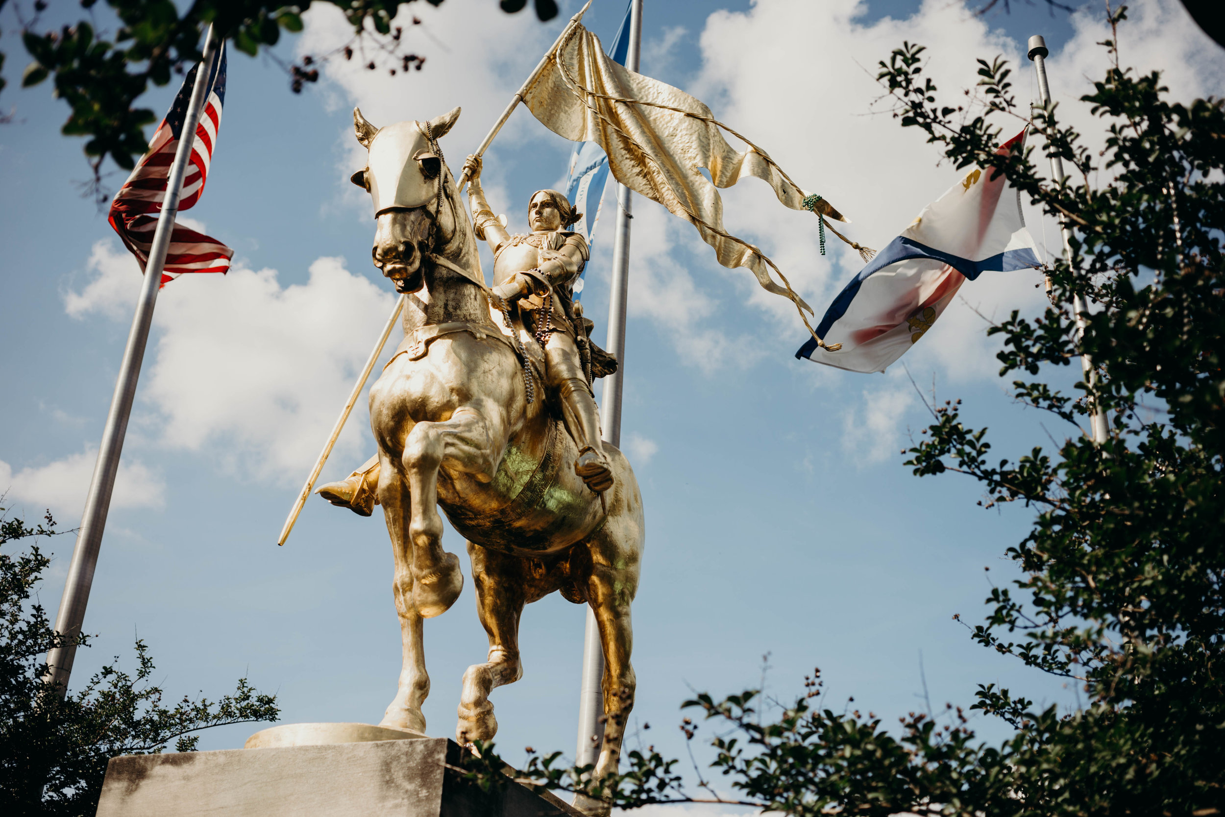 Joan of Arc, the Maid of Orleans watches over the city as its Patron Saint. - A gift from France in 1953, this gilded statue portrays the defender of Orléans in a victorious pose.
