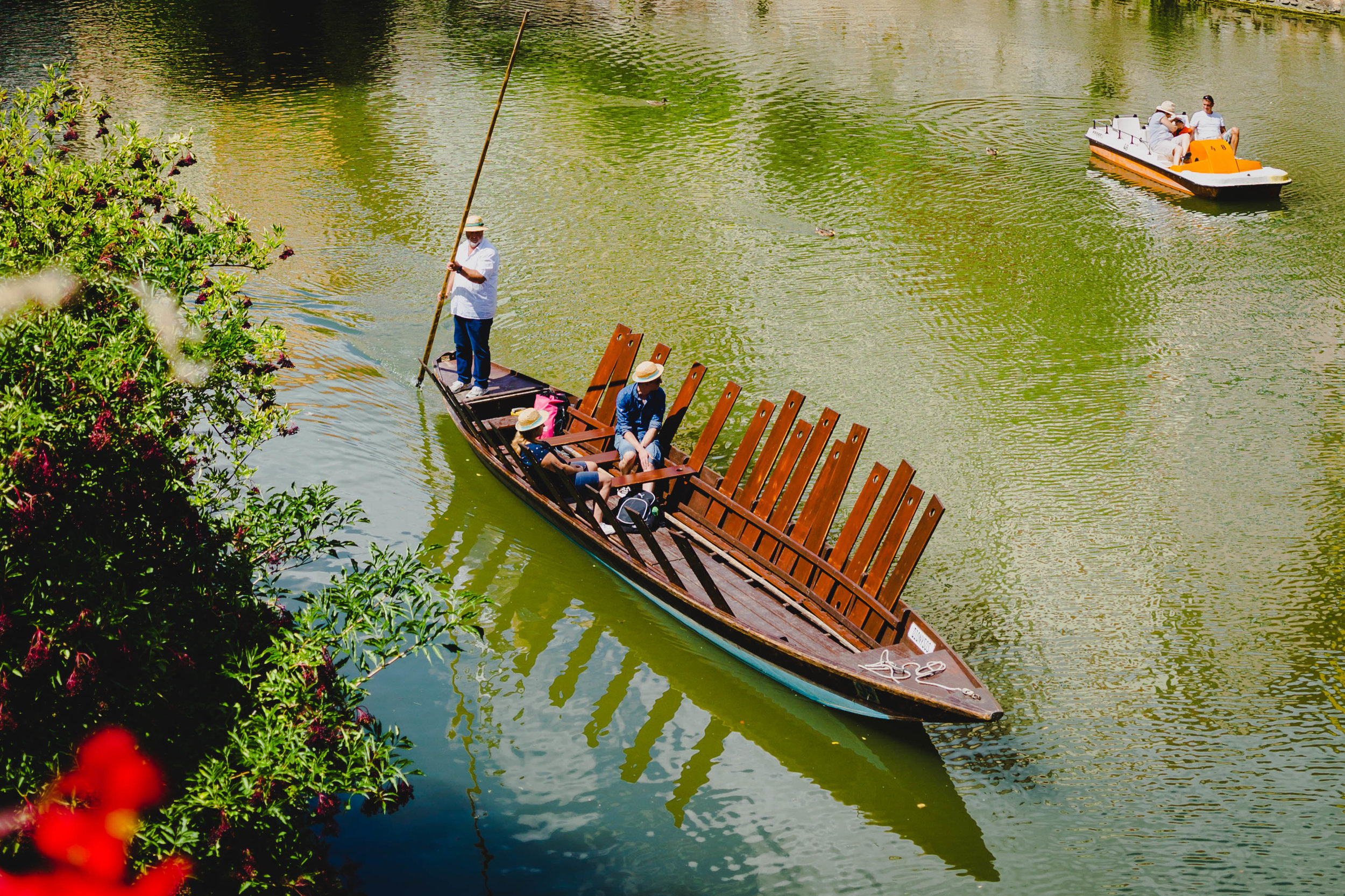 5. Take a ride on a punt boat. - On the edge of the river, you can take a punt boat tour up and down the river. If you prefer to proppell your own boat there are canoes, paddle boards and peddle boats available for rental.