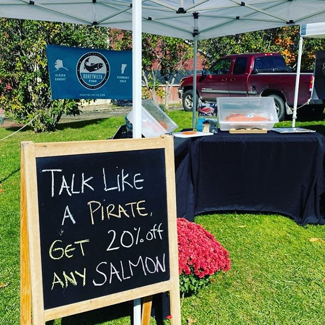 "Maria is really getting in to the ""pirate"" market at the @waitsfieldfarmersmarket .  You should too!! Go talk like a pirate! #salmonpirate #piratemarket #talklikeapirate #arrrrr"