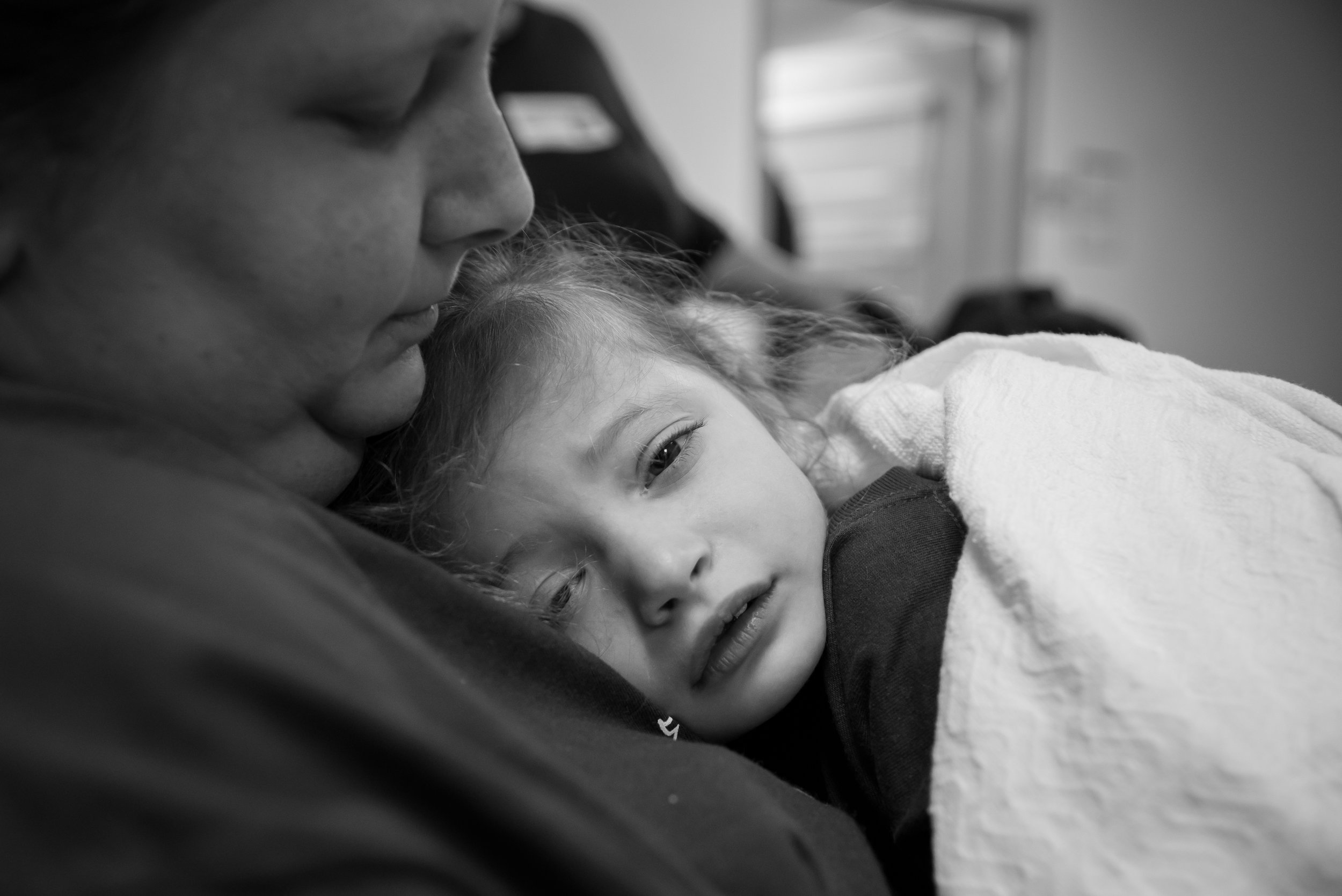 Three-year-old Arianna Failla whimpers in her mother's arms after waking up from an anesthesic that was given to her prior to an MRI at Upstate Golisano Children's Hospital in Syracuse, N.Y.
