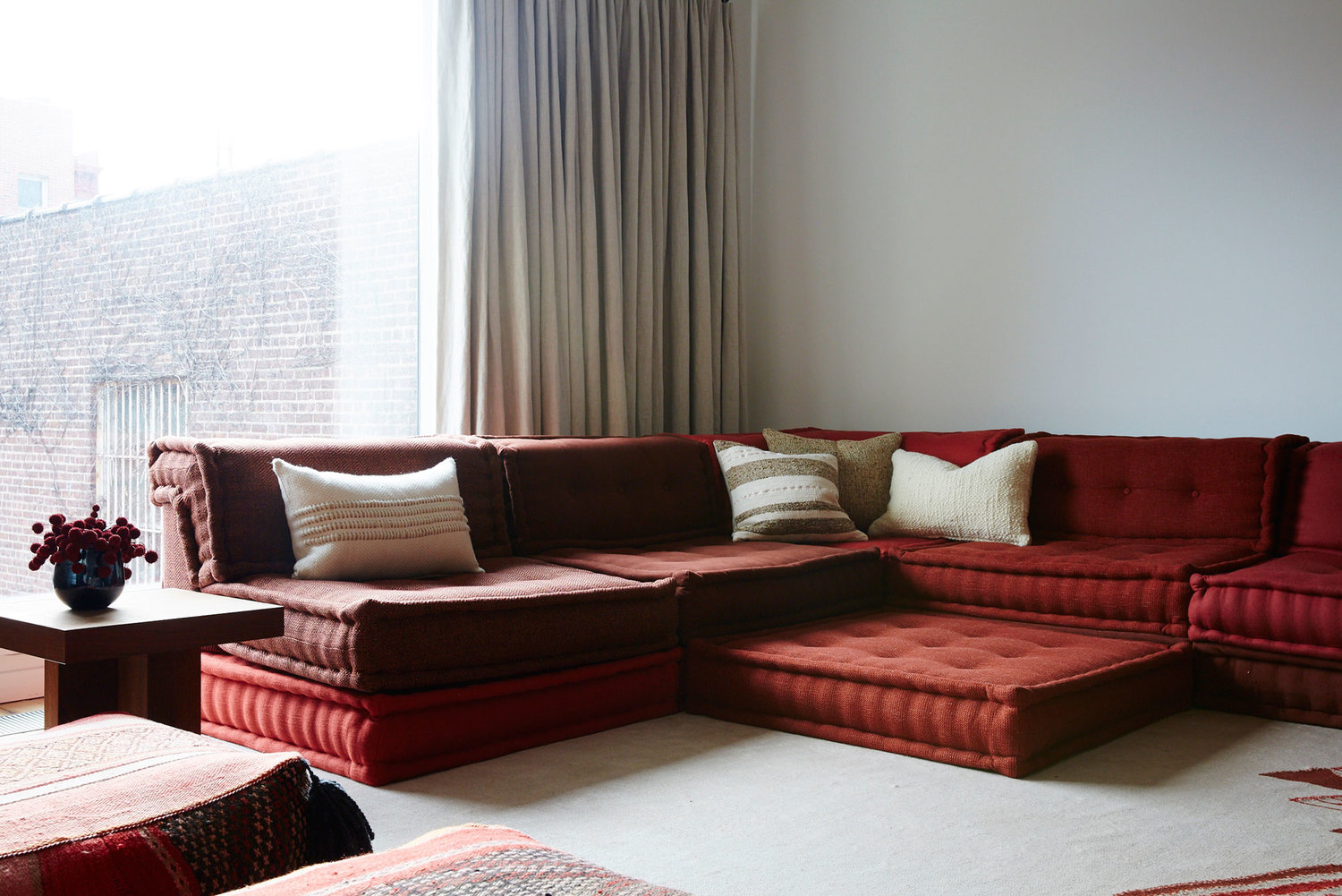 Interior by  Jesse Parris-Lamb  of New York featuring the Mah-Jong modular sofa. It doesn't get much lower than this! Photo by  Nicole Franzen