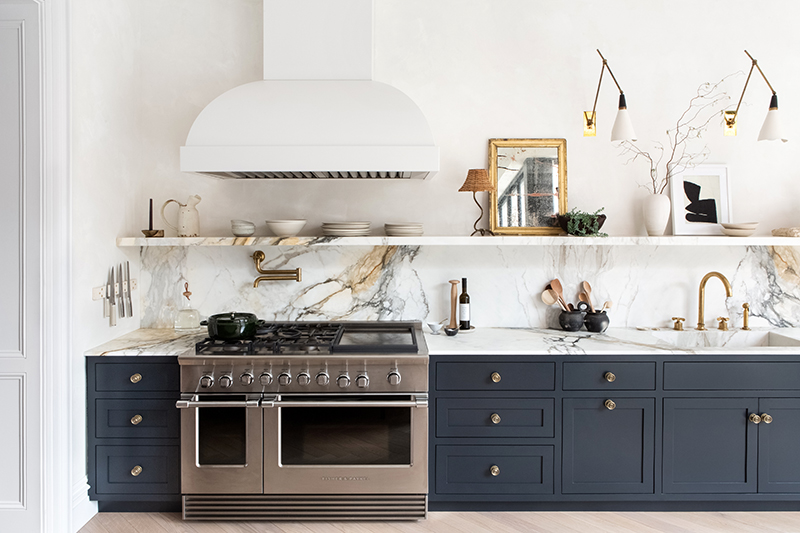 When you love marble so much that even the kitchen sink is marble. This kitchen is ticking a lot of boxes right now, from its curved rangehood, stone shelf for display, a serious Fisher and Paykel cooker, wall lights and even a pot-filler. This gorgeous kitchen was designed by  Athena Calderone,  for her own home. Photo –  Sarah Elliott .