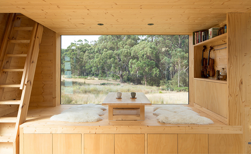 this Japanese-inspired ' Hideaway ' cabin on Tasmania's Bruny Island was designed as a place of refuge by local firm  Maguire Devine . It enjoys unencumbered views out to the natural surrounds. Photo – Robert Maver.