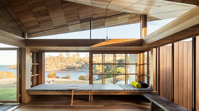Dramatic panoramic views across the coastline of the north end of Bruny Island from Captain Kelly's Cottage by  John Wardle Architects . Photo –  Trevor Mein .