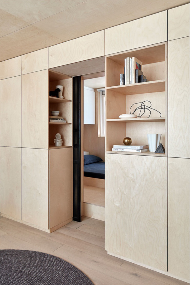 Timber cladding combines with seamless concealed joinery, offering hidden storage space, in the minimalist micro-living apartment in Richmond by  T-A Square  architects. Photo –  Jack Lovel