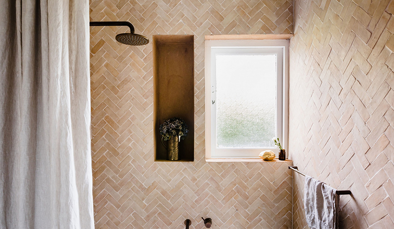 (above) Textured tiles in a captivating herringbone pattern in a project by  Georgia Ezra . Photo – courtesy of  Georgia Ezra .