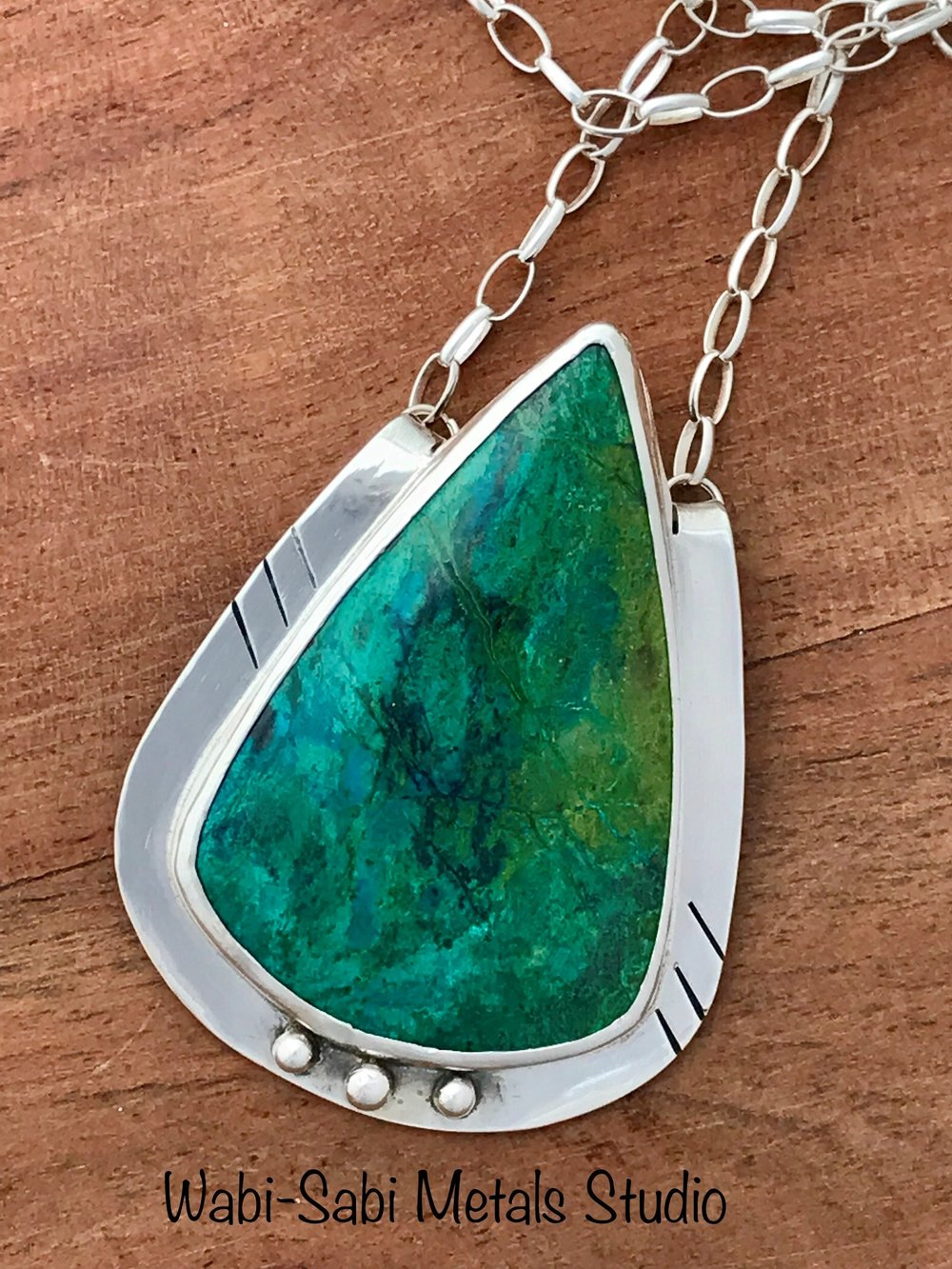 handmade metalsmith Natural parrot wing chrysocolla pendant necklace with sterling silver