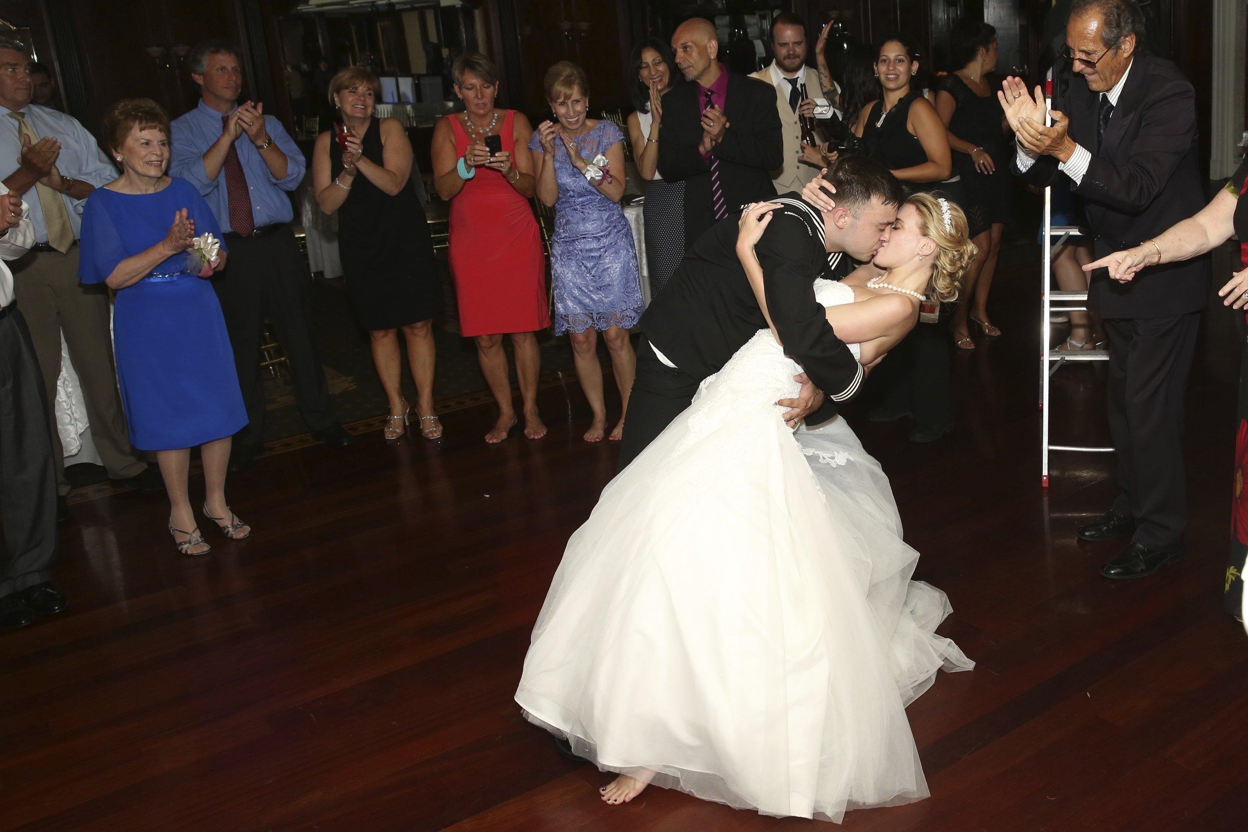 wedding kiss guests.jpg