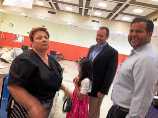 MARK ZARETSKY — NEW HAVEN REGISTER Kamran Farid, right, shares a laugh with Forest School lead cook Sally Paturzo, who was working there back when Farid was a student. With them are Principal Tom Hunt and Farid's daughter, Salma, 8.