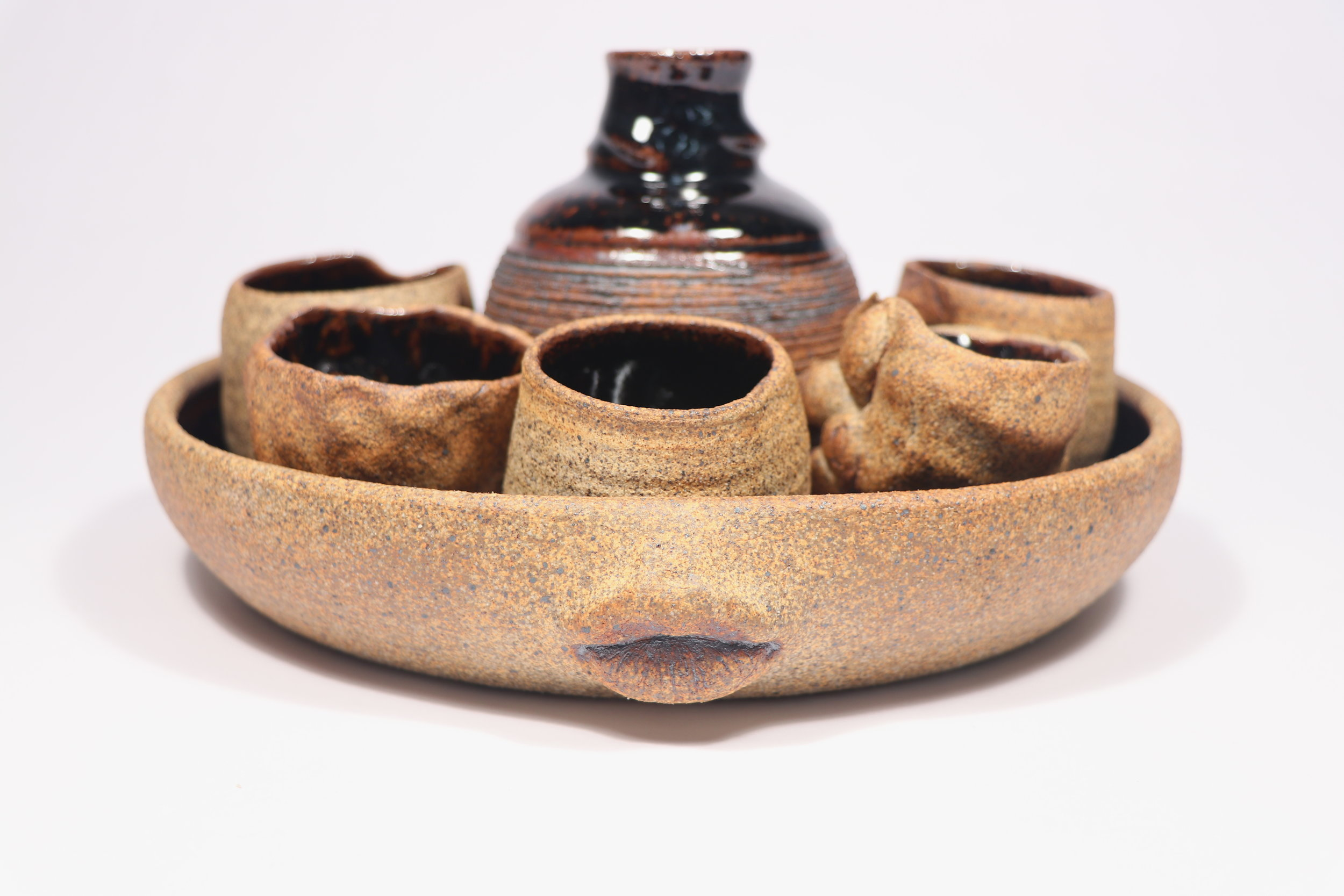 Sake set: The Consecration, Ceramics, Cone 10 Reduction, Tray: 9.5 x 7 x 1.75in, 2017. Cups: 7.5 (belly) x 2.5inBottle: 11 (belly) x 5in