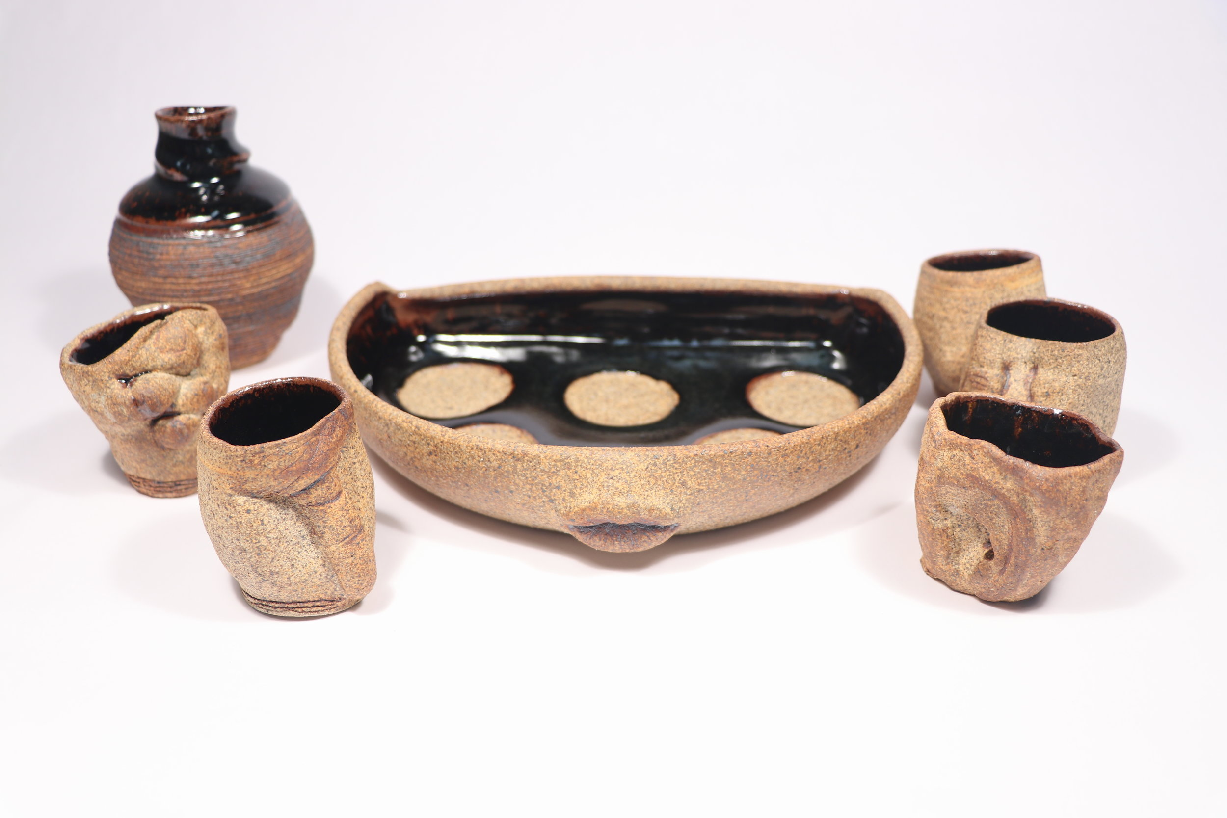 Sake set: The Consecration, Ceramics, Cone 10 Reduction, Tray: 9.5 x 7 x 1.75in, 2017. Cups: 7.5 (belly) x 2.5in Bottle: 11 (belly) x 5in 2017.